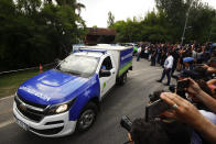 An ambulance carrying the body of Diego Maradona leaves his house in Buenos Aires, Argentina, Wednesday, Nov. 25, 2020. The Argentine soccer great who was among the best players ever and who led his country to the 1986 World Cup title before later struggling with cocaine use and obesity, died from a heart attack on Wednesday at his home in Buenos Aires. He was 60. (AP Photo/Marcos Brindicci)