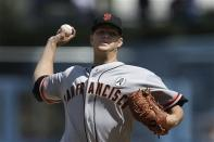 San Francisco Giants starting pitcher Matt Cain throws during the first inning of a season opening baseball game against the Los Angeles Dodgers in Los Angeles, Monday, April 1, 2013. (AP Photo/Jae C. Hong)