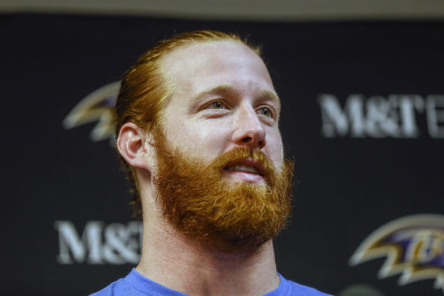 FILE - In this Dec. 8, 2019, file photo, Baltimore Ravens tight end Hayden Hurst talks with reporters following an NFL football game in Orchard Park, N.Y. The Atlanta Falcons are expected to announce a trade with Baltimore for tight end Hayden Hurst. The Falcons, who are cutting running back Devonta Freeman and cornerback Desmond Trufant, among others, in cost-cutting moves, are hoping Hurst will replace Austin Hooper, who signed with Cleveland as a free agent. (AP Photo/John Munson, File)