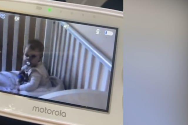 Hilarious footage shows the moment a crafty baby pretends to be asleep