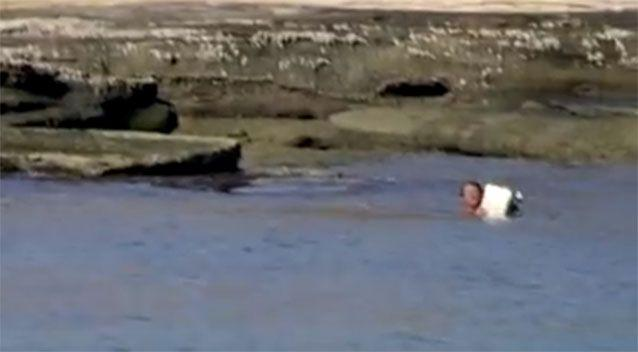 The crew was astounded to find the fisherman, who desperately tried to swim toward them. Photo: Animal Planet/ River Monsters