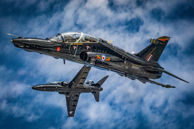 Image of two RAF T2 Hawks flying in formation. The Photo chase took place over North Wales, and involved the IV(R) Sqn and XXV(F) Sqn Hawks (Picture: UK MOD/Crown 2019)