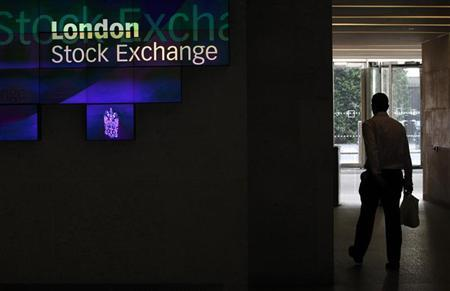A man walks through the lobby of the London Stock Exchange