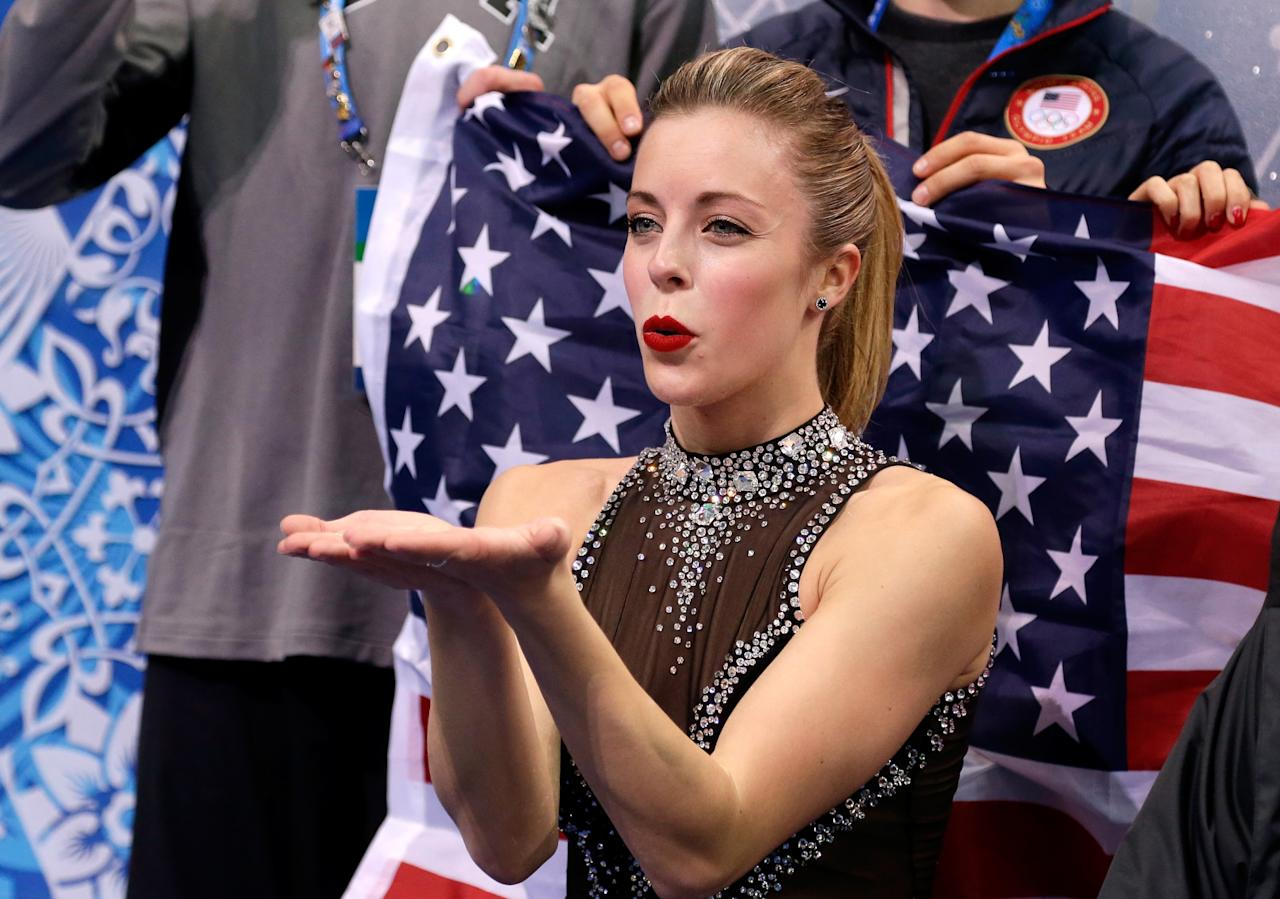 SOCHI, RUSSIA - FEBRUARY 08: Ashley Wagner of the United States waits for her score with teammates and coaches during the Figure Skating Team Ladies Short Program during day one of the Sochi 2014 Winter Olympics at Iceberg Skating Palace on February 8, 2014 in Sochi, Russia. (Photo by Darren Cummings/Pool/Getty Images)