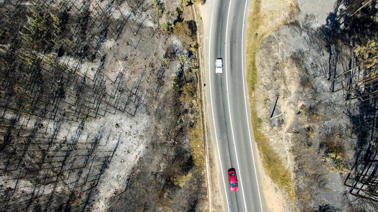 <p>Aerial view taken with a drone of a forest devastated by fire near La Florida, Bio Bio region , some 420 km south of Santiago, on January 29, 2017. (Christian Miranda/AFP/Getty Images) </p>