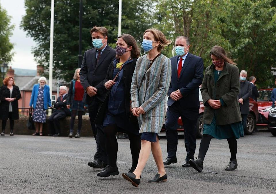 (Left-right) Pat Hume's children John Junior, Mo, Therese, Aidan (left back) and Aine (right back) arrive at St Eugene's Cathedral (Liam McBurney/PA) (PA Wire)