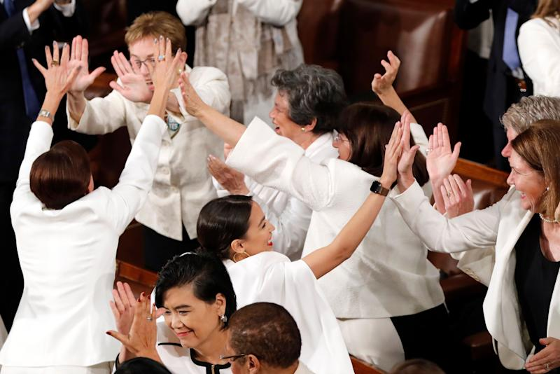 Members of Congress cheer after President Donald Trump acknowledges more women in Congress during his State of the Union address to a joint session of Congress on Capitol Hill in Washington, Tuesday, Feb. 5, 2019.(AP Photo/J. Scott Applewhite)