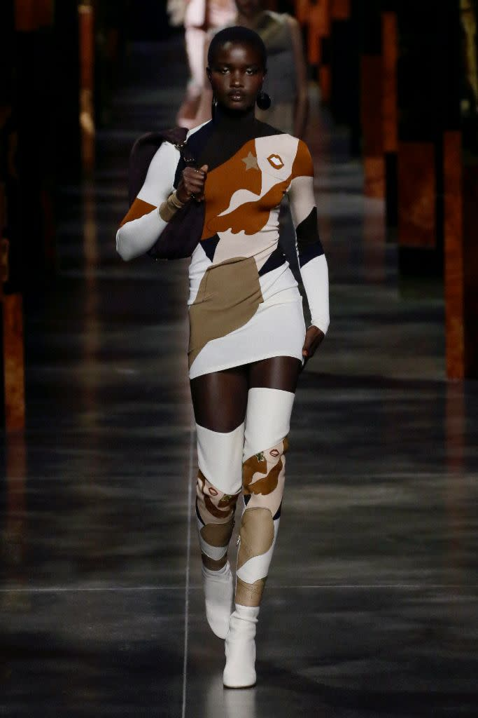 Fendi's spring '22, which include over-the-knee boots done in the artwork of Antonio Lopez. - Credit: Courtesy of Fendi