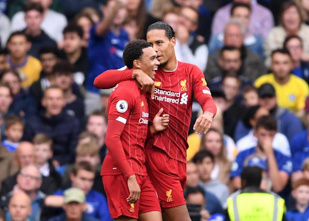Liverpool's Trent Alexander-Arnold (L) is congratulated by Liverpool teammate Virgil van Dijk after scoring against Chelsea on Sunday. (Laurence Griffiths/Getty)