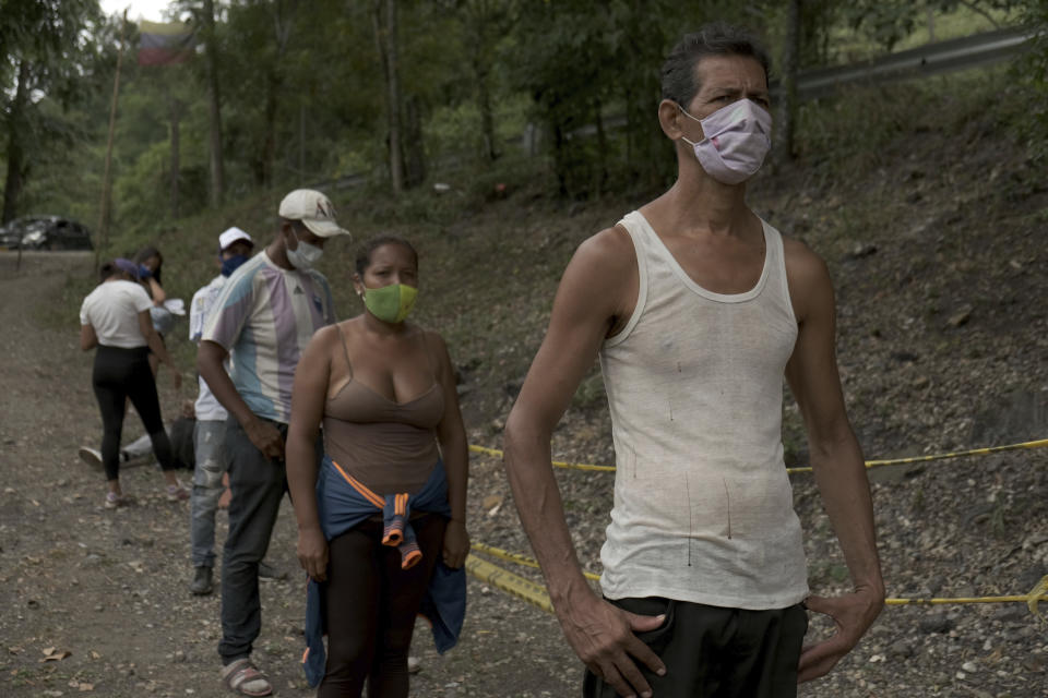 Venezuela migrant Jose Rivas, 52, stands in line for aid from Colombia's Red Cross in Pamplona, Colombia, Wednesday, Oct. 7, 2020, a few hours by car from the Venezuelan government. The new migrants are encountering decidedly more adverse conditions than those who fled their homeland before COVID-19. (AP Photo/Ferley Ospina)