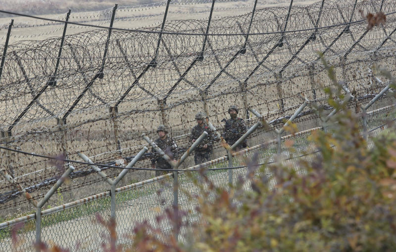 "South Korean army soldiers patrol along the barbed-wire fence in Paju, South Korea, near the border with North Korea, Friday, Nov. 16, 2018. North Korean leader Kim Jong Un observed the successful test of ""a newly developed ultramodern tactical weapon,"" the nation's state media reported Friday, though it didn't describe what sort of weapon it was.(AP Photo/Ahn Young-joon)"