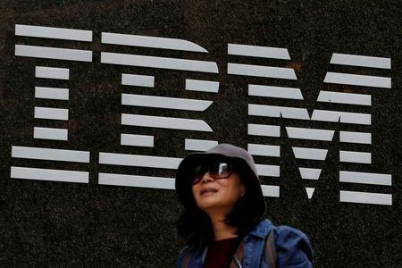 FILE PHOTO - A woman passes by the IBM offices in New York