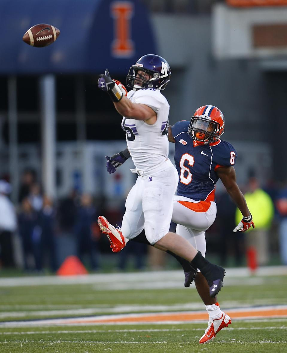 Northwestern linebacker Collin Ellis (45) breaks up a pass intended for Illinois running back Josh Ferguson (6) during the first half of an NCAA college football game on Saturday, Nov. 30, 2013, in Champaign, Ill. (AP Photo/Jeff Haynes)