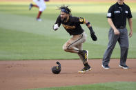 San Diego Padres' Fernando Tatis Jr., left, runs toward third after he stole second and advanced to third on a throwing error by Washington Nationals catcher Rene Rivera (not shown) during the first inning of a baseball game, Friday, July 16, 2021, in Washington. (AP Photo/Nick Wass)