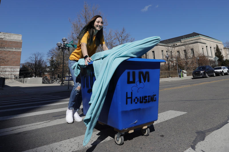 ANN ARBOR, MICHIGAN - MARCH 17: Peyton Grant of Lavallette, New Jersey pack up and moves out of her dorm at the University of Michigan on March 17, 2020 in Ann Arbor, Michigan. College students across America are being told to leave campus and continue classes online after the World Health Organization (WHO) declared Coronavirus (COVID-19) a pandemic. (Photo by Gregory Shamus/Getty Images)