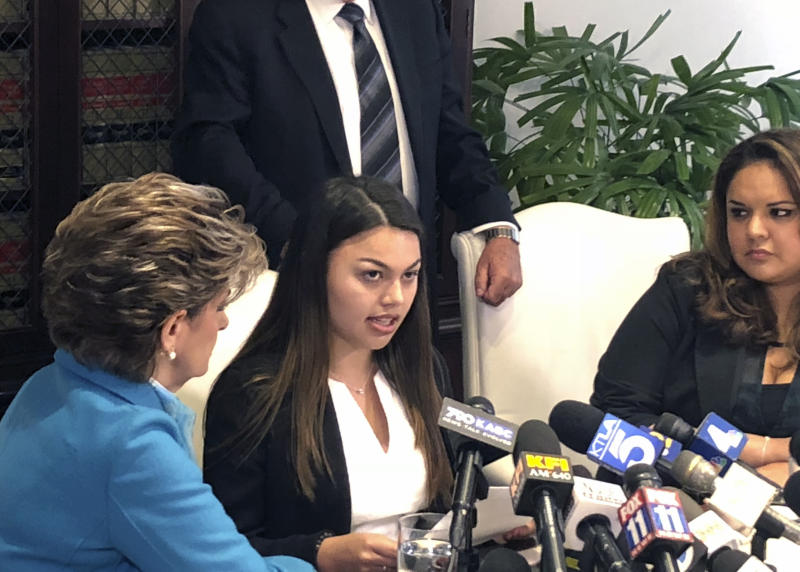 University of Southern California student Daniella Mohazab, center, speaks at a news conference at the office of her attorney, Gloria Allred, left, Tuesday May 22, 2018, in Los Angeles. Mohazab, a USC student seeking a master's degree in communications management, is suing USC and an ex-campus gynecologist who she accuses of sexual battery. (AP Photo/Christopher Weber)