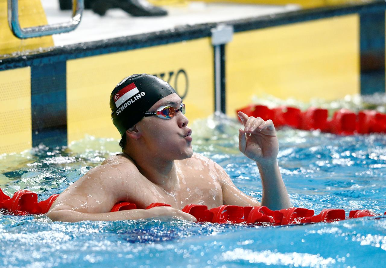 Southeast Asian (SEA) Games - Swimming Men's 50 meters Butterfly Final - National Aquatic Center, Kuala Lumpur - August 21, 2017 - Joseph Schooling of Singapore reacts after the race. REUTERS/Lai Seng Sin