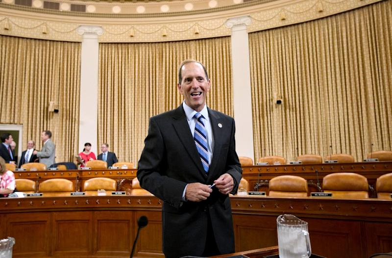 "House Ways and Means Committees Chairman Rep. Dave Camp, R-Mich., arrives on Capitol Hill in Washington, Tuesday, July 10, 2012, to lead a hearing on the implications of the Supreme Court's ruling that the individual mandate in the ""Affordable Care Act"" is constitutional, particularly as it relates to Congress' authority to lay and collect new taxes. (AP Photo/J. Scott Applewhite)"