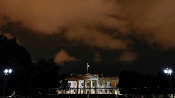 PHOTO: The White House is lit before dawn after President Donald Trump announced that he and first lady Melania Trump have both tested positive for COVID-19 in Washington, D.C., Oct. 2, 2020. (Joshua Roberts/Reuters)