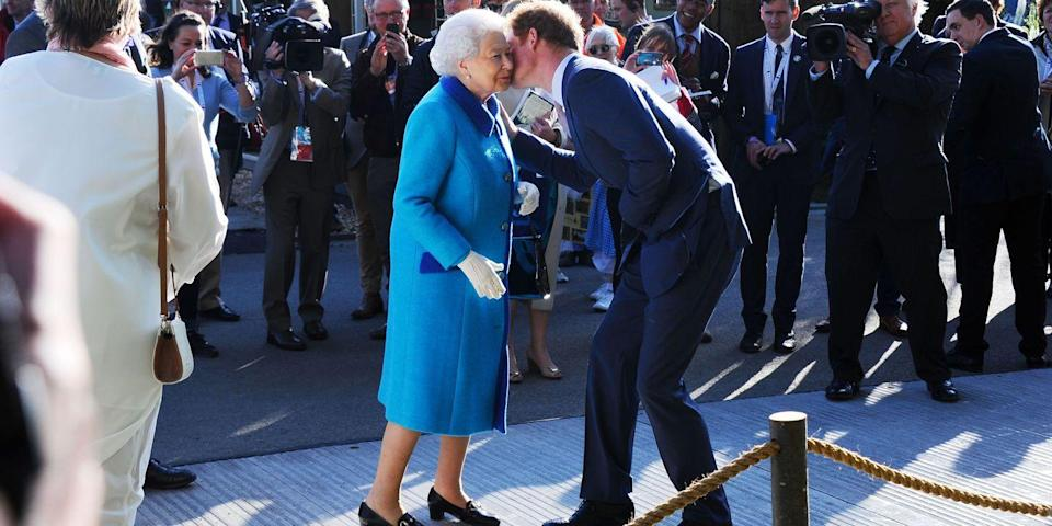 <p>Prince Harry greets Queen Elizabeth II with a kiss on the cheek at the Chelsea Flower show. </p>