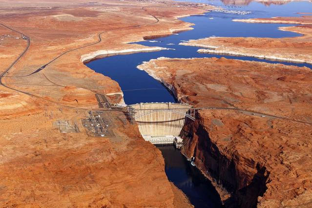 <p>Glen Canyon Bridge and Dam, Arizona. The bridge has an overall length of 1,271 feet (387 m) with a deck 700 feet (210 m) above the Colorado river, making it one of the highest bridges in the US. It was completed in 1959. The dam was completed just a few years later, in 1966. (Photo: Jassen Todorov/Caters News) </p>