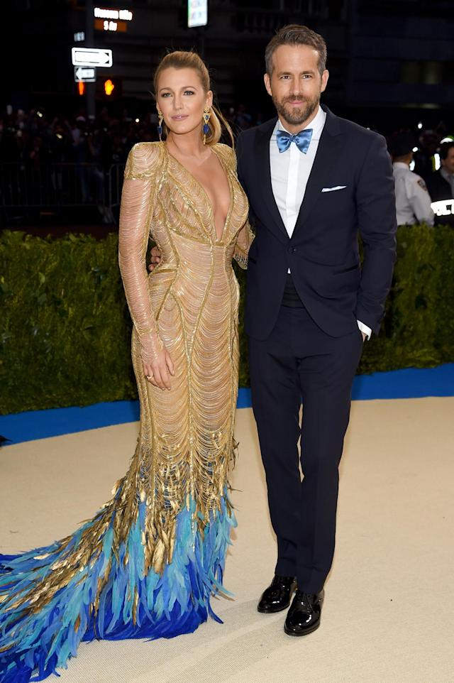 <p>Ryan Reynolds's bowtie matched the feather train of his wife's incredible Versace gown. (Photo by Dimitrios Kambouris/Getty Images) </p>