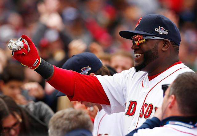 BOSTON, MA - APRIL 04: David Ortiz #34 of the Boston Red Sox shows off his World Series rings prior to the Opening Day game between the Boston Red Sox and the Milwaukee Brewers at Fenway Park on April 4, 2014 in Boston, Massachusetts. (Photo by Jared Wickerham/Getty Images)