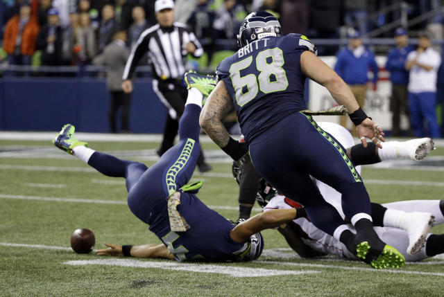 Seattle Seahawks quarterback Russell Wilson fumbles the ball as he is upended on a sack by the Atlanta Falcons in the first half of an NFL football game, Monday, Nov. 20, 2017, in Seattle. (AP Photo/Ted S. Warren)