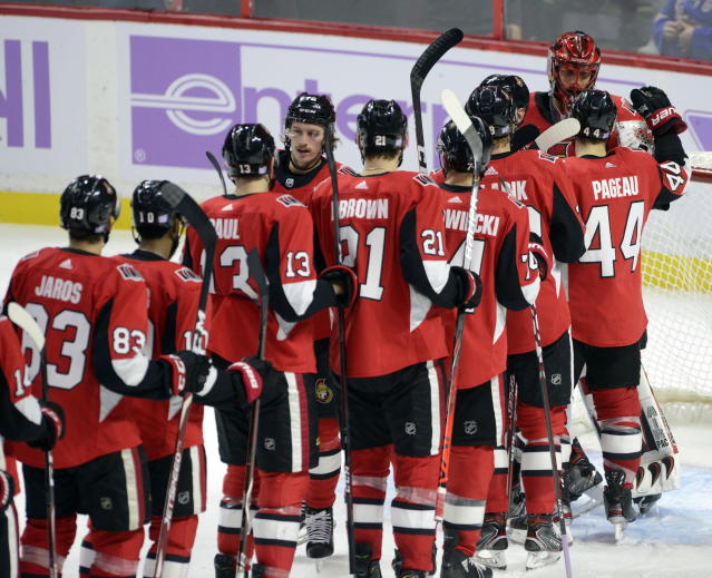 Ottawa Senators players line up to congratulate goaltender Anders Nilsson (31) after defeating the New York Rangers 4- in an NHL hockey game Friday, Nov. 22, 2019, in Ottawa, Ontario. (Sean Kilpatrick/The Canadian Press via AP)