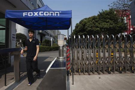 A worker leaves a Foxconn factory in the township of Longhua in Shenzhen