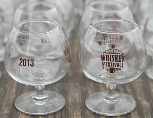 Reusable tasting glasses for participants sit at the entrance of the Tennessee Whiskey Festival at the First Tennessee Pavilion in Chattanooga, Tenn., Sept. 21, 2013