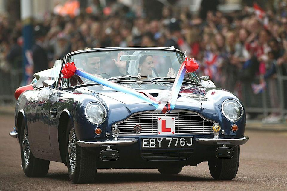 <p>One of the more non-traditional elements to the royal wedding was the new Duke and Duchess of Cambridge driving off down the Mall in a convertible Aston Martin, with a 'JU5T WED' number plate on the back.</p><p>The car was actually loaned to them by William's father, Prince Charles, who was gifted the car on his 21st birthday by his mother, the Queen.</p>