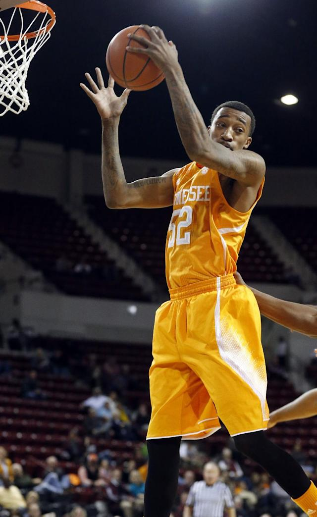 Tennessee guard Jordan McRae (52) hauls in a rebound against Mississippi State in the first half of an NCAA college basketball game in Starkville, Miss., Wednesday, Feb. 26, 2014. (AP Photo/Rogelio V. Solis)