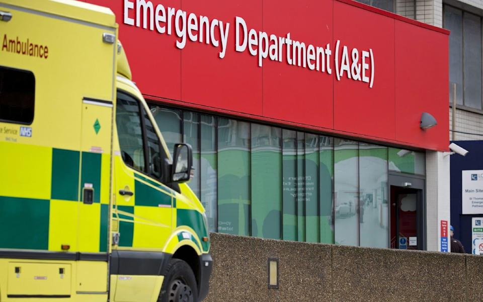 An ambulance is parked outside an Accident and Emergency department - AFP
