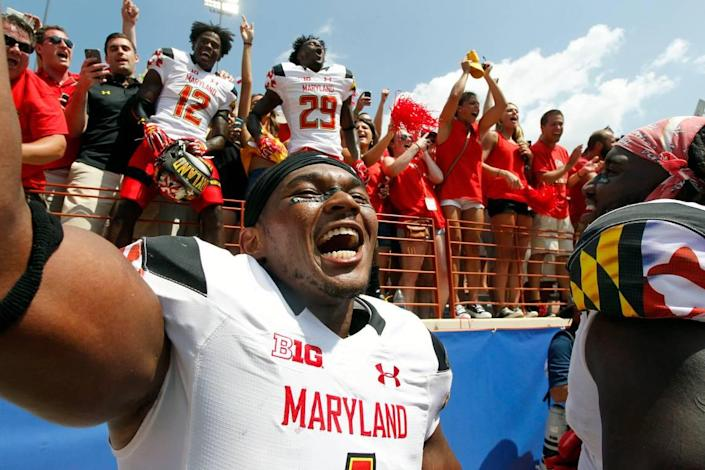 The Carolina Panthers selected Maryland linebacker Jermaine Carter, front, in Saturday's fifth round of the 2018 NFL Draft.