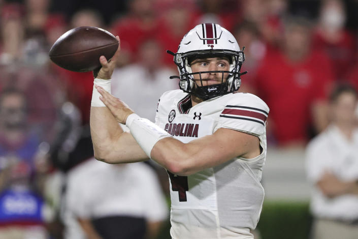 South Carolina quarterback Luke Doty (4) throws a pass against Georgia during the first half of an NCAA college football game Saturday, Sept. 18, 2021, in Athens, Ga. (AP Photo/Butch Dill)