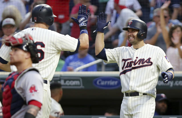 Minnesota Twins' Max Kepler (26) is congratulated by Twins' Brian Dozier after both scored on a two-run home run by Kepler against the Boston Red Sox in the fourth inning of a baseball game Wednesday, June 20, 2018, in Minneapolis. (AP Photo/Andy Clayton-King)