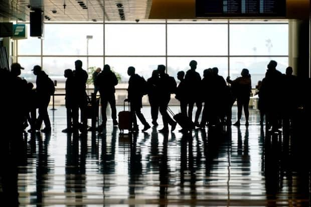 The Global Business Travel Association, an industry group, said business travel accounted for about 2.5 to 3 per cent of Canada's GDP pre-pandemic, about $40 billion annually.  (Rick Bowmer/The Associated Press - image credit)