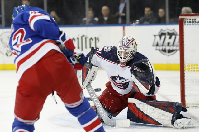 New York Rangers defenseman Brendan Smith (42) shoots as Columbus Blue Jackets goaltender Matiss Kivlenieks (80) reacts during the second period of an NHL hockey game, Sunday, Jan. 19, 2020, in New York. (AP Photo/Kathy Willens)
