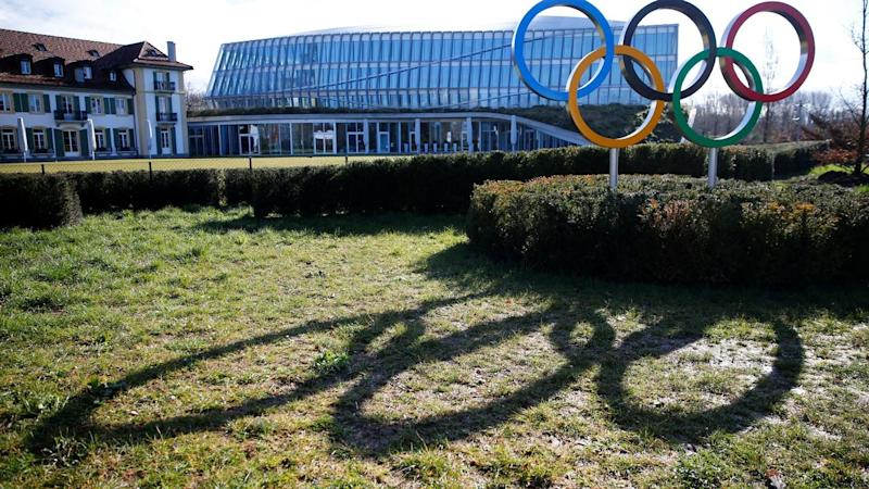 The rings are pictured in front of the IOC