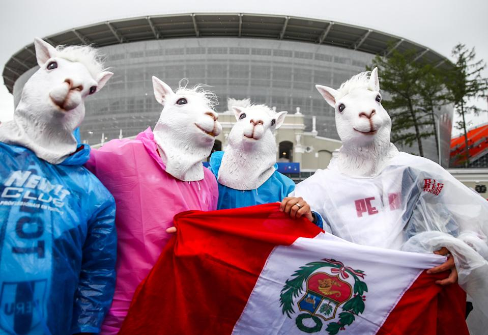 <p>Peru-ving themselves: Peru fans get in on the act before their opening fixture against Denmark. (Getty) </p>