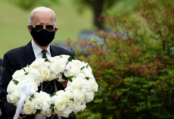 White House hopeful and former US vice resident Joe Biden attended his first public event in months March 25, 2020, wearing a mask as a precaution against the coronavirus, in contrast to President Donald Trump who has refused to wear one in public (AFP Photo/Olivier DOULIERY)