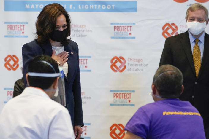 Vice President Kamala Harris talks with Lucio Polanco, a high-rise window washer, as he received the Johnson & Johnson COVID-19 vaccination from Osman Meah at COVID-19 vaccination site, Tuesday, April 6, 2021, in Chicago, as Sen. Dick Durbin, D-Ill., watches. The site is a partnership between the City of Chicago and the Chicago Federation of Labor. (AP Photo/Jacquelyn Martin)
