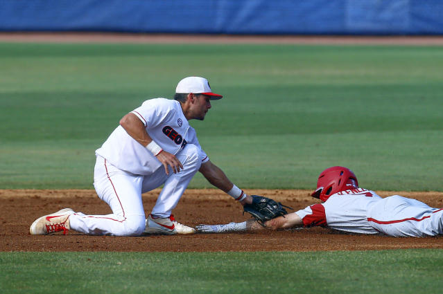 Arkansas' Jack Kenny (7) is tagged out by Georgia shortstop Cam Shepherd (7) as he tried to steal second base during the first inning of a Southeastern Conference tournament NCAA college baseball game Thursday, May 23, 2019, in Hoover, Ala. (AP Photo/Butch Dill)