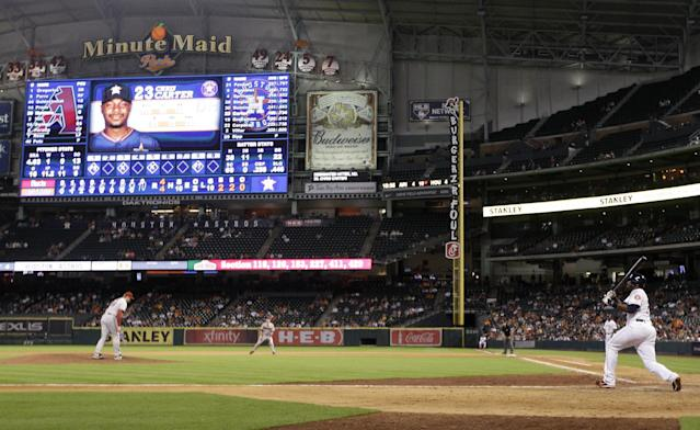 Houston Astros' Chris Carter follows through on a home run in the 10th inning of a baseball game against the Arizona Diamondbacks, Thursday, June 12, 2014, in Houston. The Astros won 5-4. (AP Photo/Patric Schneider)