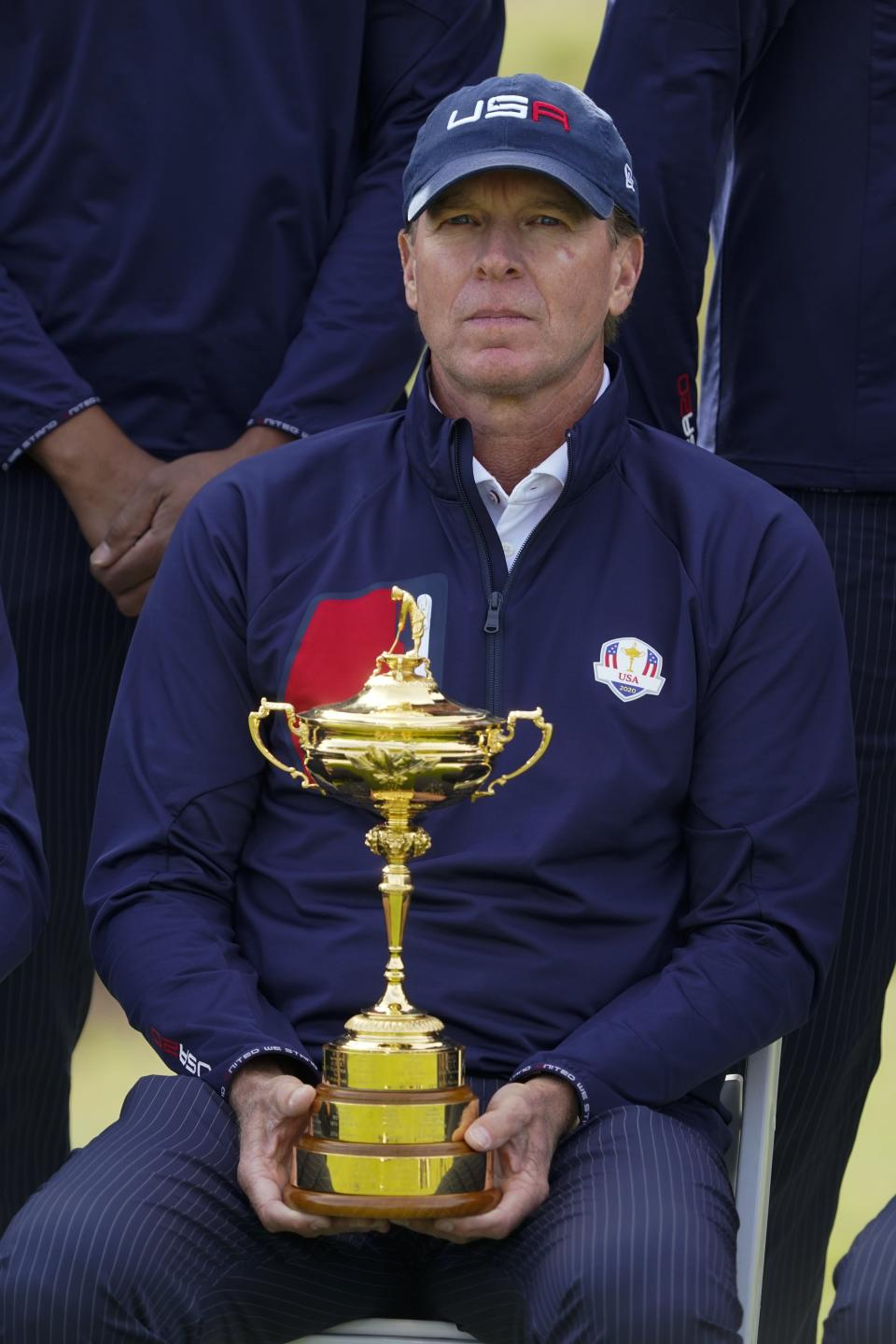 Team USA captain Steve Stricker holds the Ryder Cup as they pose for a picture on the 18th hole during a practice day at the Ryder Cup at the Whistling Straits Golf Course Wednesday, Sept. 22, 2021, in Sheboygan, Wis. (AP Photo/Charlie Neibergall)
