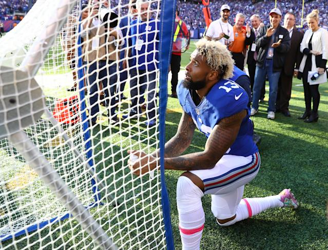 "Odell Beckham Jr. of the New York Giants kneels in front of the kicking net after scoring the go-ahead touchdown against the <a class=""link rapid-noclick-resp"" href=""/nfl/teams/baltimore/"" data-ylk=""slk:Baltimore Ravens"">Baltimore Ravens</a> in the fourth quarter during their game at MetLife Stadium on October 16, 2016, in East Rutherford, New Jersey. (Al Bello/Getty Images)"