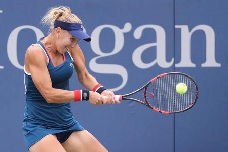 Elena Vesnina of Russia returns a shot to Carla Suarez Navarro of Spain on day six of the 2016 U.S. Open tennis tournament at USTA Billie Jean King National Tennis Center. Mandatory Credit: Anthony Gruppuso-USA TODAY Sports