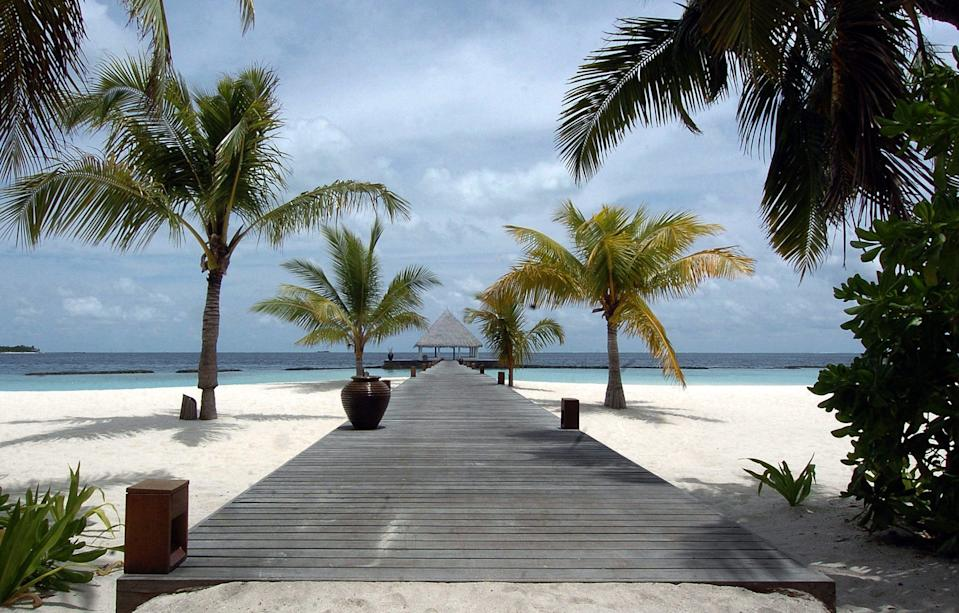 The convicted fraudster jetted to glamorous destinations around the world, including the MaldivesAFP via Getty Images