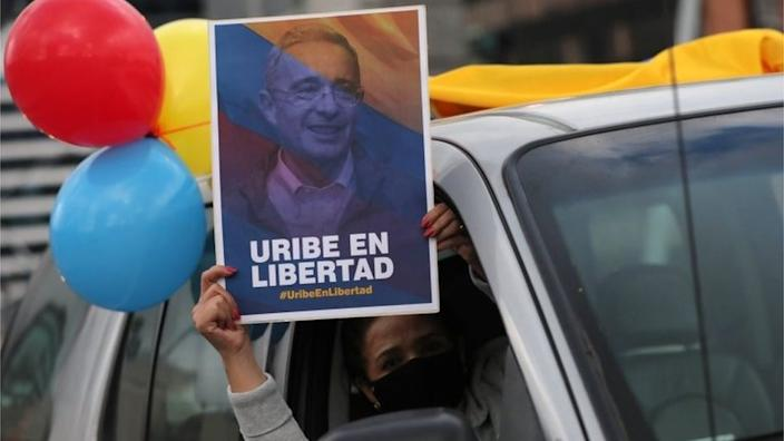 Álvaro Uribe's supporters have taken to the streets in protest after he was placed under house arrest